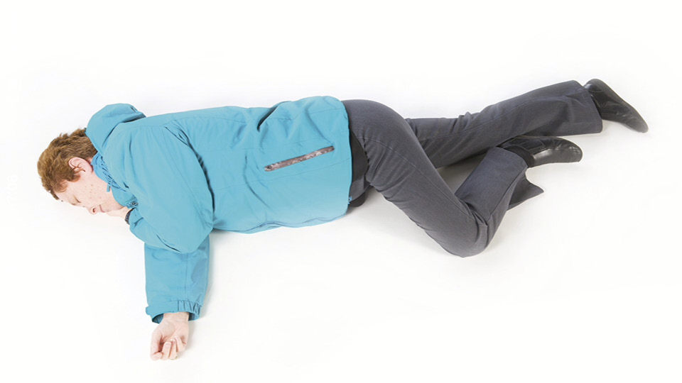 If the casualty is unconscious and breathing, place them in the recovery position until medical help arrives